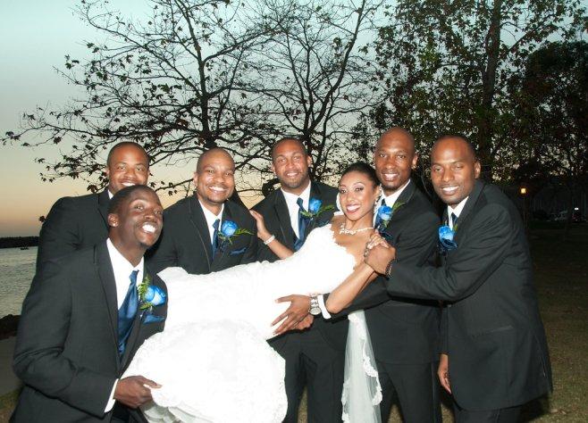bride held by groomsmen